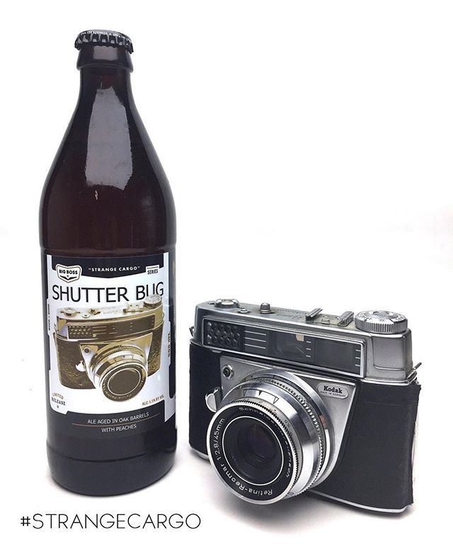 "When you visit @big_boss_taproom this weekend make sure you ""snap"" up a couple of these bottles!  Shutter Bug is a barrel aged peach ale with brettanomyces. Fruity, Earthy deliciousness is in 500 ml bottles available only from us.  We will ""develop"" a limited supply of kegs later in the year. Thanks to @woodyjacobs for the camera! #ncbeer #strangecargo #craftbeer #woodandbeer #barrelaged"